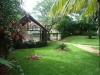 Parcheggio coperto e giardino villa in residence fronte mare a Sosua
