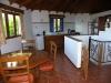 Eethoek en keuken van een van de villas