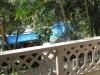 Balcon met zicht op zwembad