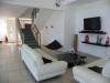 Salon met trap naar verdieping